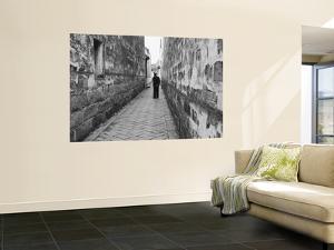 Man Standing in Narrow Alleyway, Tongli, Jiangsu, China by Ian Trower