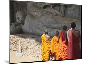 Monks at Reclining Buddha Statue, Gal Vihara, Polonnaruwa, UNESCO World Heritage Site, Sri Lanka by Ian Trower