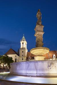 Old Town Hall and Roland's Fountain in Hlavne Nam (Main Square) at Dusk by Ian Trower