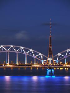 Railway Bridge across Daugava River with Tv Tower in Background, Riga, Latvia by Ian Trower