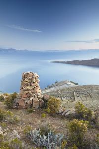 Stack of Prayer Stones on Isla del Sol (Island of the Sun), Lake Titicaca, Bolivia, South America by Ian Trower