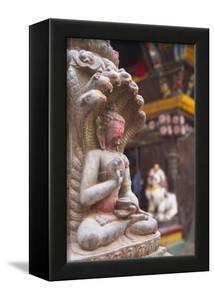 Statue at Bhimsen Temple, Kathmandu, Nepal, Asia by Ian Trower