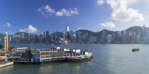 View of Star Ferry Terminal and Hong Kong Island skyline, Hong Kong, China by Ian Trower