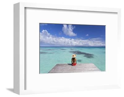 Woman Sitting on Jetty, Fakarava, Tuamotu Islands, French Polynesia (Mr)