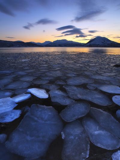 Ice Flakes Drifting Towards the Mountains on Tjeldoya Island, Norway-Stocktrek Images-Photographic Print