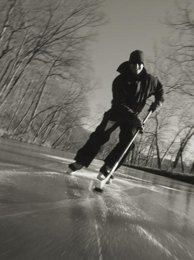 Ice Skater with a Hockey Stick on the Frozen C and O Canal-Skip Brown-Photographic Print