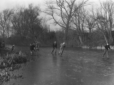 Ice Skating on a River--Photographic Print