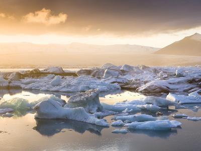 Icebergs Floating on the Jokulsarlon Glacial Lagoon at Sunset, Iceland, Polar Regions-Lee Frost-Photographic Print