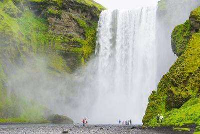 Iceland. South. Skogafoss. Hikers are Skogafoss Waterfall-Inger Hogstrom-Photographic Print