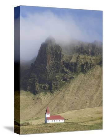 Icelandic Church Dwarfed By Mountains Rising Into Mist, Vik I Myrdal, South Iceland, Iceland