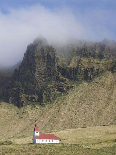 Icelandic Church Dwarfed By Mountains Rising Into Mist, Vik I Myrdal, South Iceland, Iceland--Photographic Print