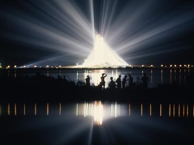 Illuminated by Spotlights, Apollo Ii Gleams and Reflects in a Lagoon-Otis Imboden-Photographic Print