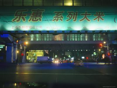 Illuminated Signs Brighten a Shanghai Street at Night--Photographic Print