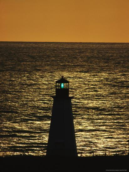 Illuminated Silhouetted Lighthouse at Sunset-Michael Melford-Photographic Print