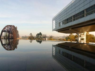Image of the Clinton Library Building and an Old Bridge Reflected in a Pool--Photographic Print