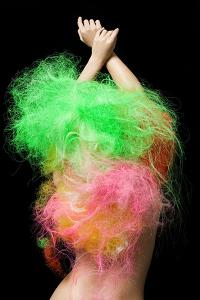 Woman with Neon Hair by Image Source