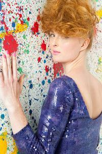 Young Woman in Sequin Dress by Image Source