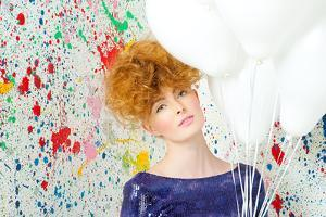 Young Woman with Balloon by Image Source