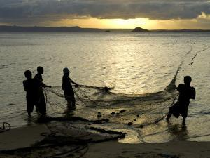 Fishermen Pulling in the Nets at Dawn, Ramena Beach, Diego Suarez, North Madagascar by Inaki Relanzon