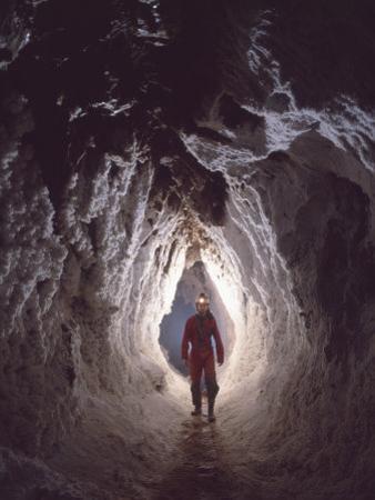 Potholer Wallking Along Narrow Underground Passage, Cova Lachambre, Ria, Conflent, Pyrenees, France