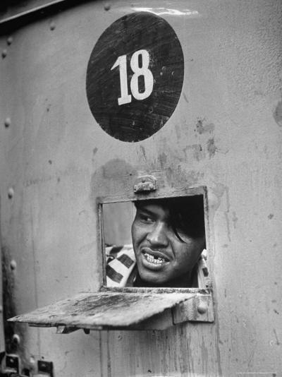 Incorrigible Killer Peering from Cell, Has Killed Two Men While in Prison-Frank Scherschel-Photographic Print