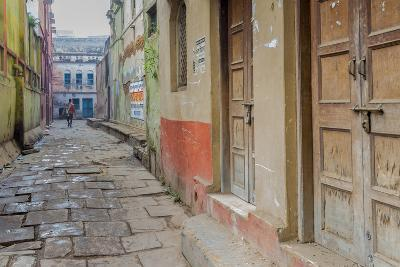 India, Varanasi a Man Walking Down a Stone Tiled Street in the Downtown Area-Ellen Clark-Photographic Print