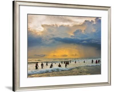 Indian Bathers Playing in Surf During Cloudy Sunset-Tim Makins-Framed Photographic Print