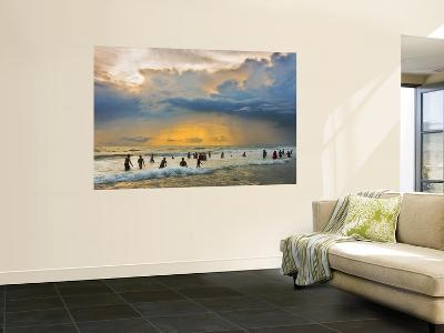 Indian Bathers Playing in Surf During Cloudy Sunset-Tim Makins-Wall Mural