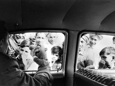 Indian children looking into puppeteer Bil Baird's car, March 1962.-James Burke-Premium Photographic Print