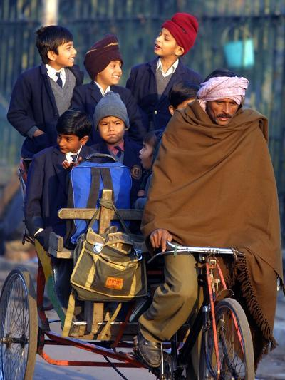 Indian Children Ride to School on the Back of a Cycle Rickshaw--Photographic Print