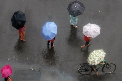 Indian Commuters under their Umbrellas to Protect Themselves from the Rain in Mumbai-Divyakant Solanki-Photographic Print