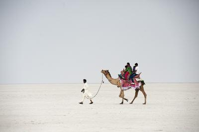 Indian Family Enjoying a Camel Ride in the White Desert-Annie Owen-Photographic Print