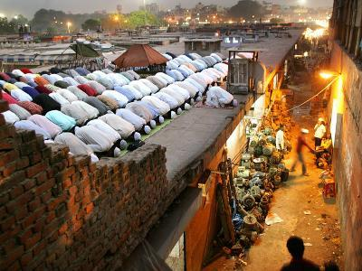 Indian Muslims During Friday Evening Prayers on the Rooftop of a Building over an Auto Parts Market--Photographic Print