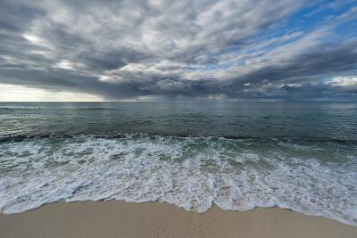Indian Ocean Surf Surging onto a Sandy Beach, under a Dramatic Cloud-Filled Sky-Sergio Pitamitz-Photographic Print