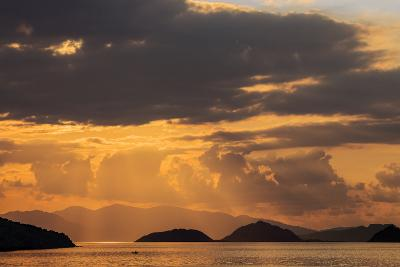 Indonesia, Lesser Sunda Islands, Rinca. Sunset over Komodo Island.-Nigel Pavitt-Photographic Print
