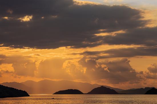 Indonesia, Lesser Sunda Islands, Rinca. Sunset over Komodo Island.-Nigel Pavitt-Photographic Print