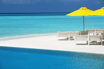 Infinity Pool and Lounge Chairs, Maldives, Indian Ocean, Asia-Sakis Papadopoulos-Photographic Print