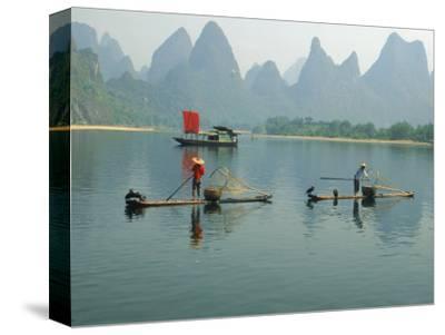 Fishermen on Bamboo Rafts, China