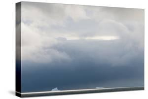 Antarctica. Bransfield Strait. Iceberg under Stormy Skies by Inger Hogstrom