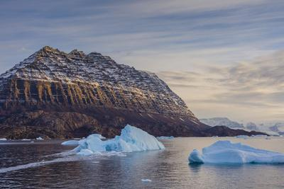 Greenland. Scoresby Sund. Icebergs and deeply eroded mountains.