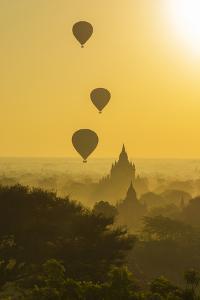 Myanmar. Bagan. Hot Air Balloons Rising over the Temples of Bagan by Inger Hogstrom