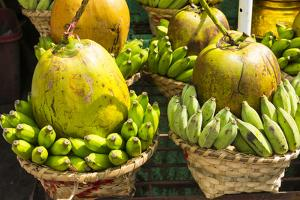 Myanmar. Yangon. Botataung Pagoda. Offerings of Fruit for Sale by Inger Hogstrom
