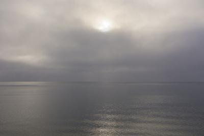 Norway. Svalbard. Nordaustlandet Island. Calm Water and Cloudy Skies