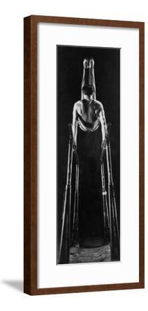 Intercollegiate Championship Gymnast Newt Loken Doing Back Somersault on Parallel Bars-Gjon Mili-Framed Premium Photographic Print