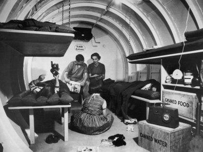 https://imgc.artprintimages.com/img/print/interior-view-of-steel-underground-radiation-fallout-shelter-where-couple-relaxes-with-3-children_u-l-p6dw350.jpg?artPerspective=n