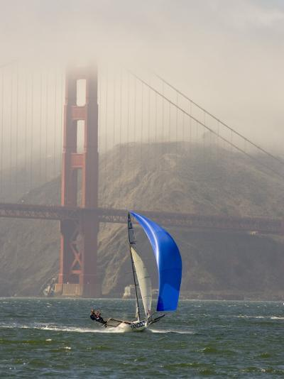 International 14 Skiff Sails under the Golden Gate Bridge, San Francisco Bay, California-Skip Brown-Photographic Print