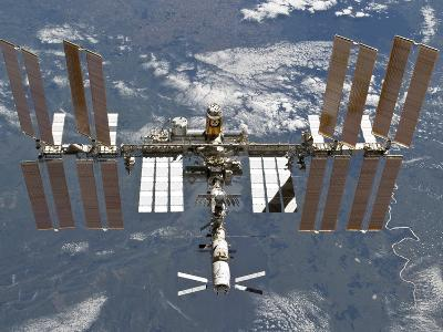 International Space Station Backgropped by a Blue and White Earth-Stocktrek Images-Photographic Print