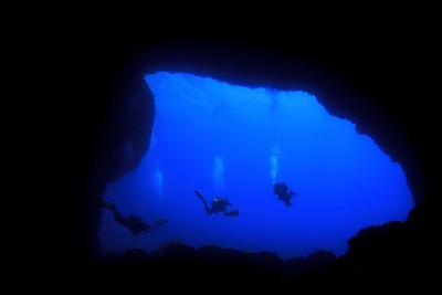 Into Darkness: Underwater Cave Scuba Diving Silhouettes-Rich Carey-Photographic Print