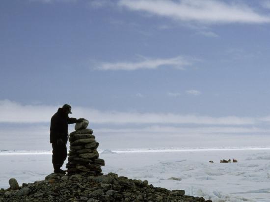 Inuit Hunter Surveys a Sacred Inuksuk Monument, Used as a Waypost-Gordon Wiltsie-Photographic Print