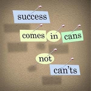 Success Comes in Cans Not Can'ts Saying on Paper Pieces Pinned to a Cork Board by iqoncept